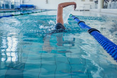 Fit swimmer doing the front stroke in the swimming pool Royalty Free Stock Images