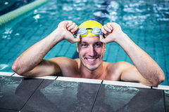 Fit swimmer lean on edge of the swimming pool. At leisure center Stock Images