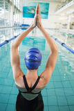 Fit swimmer in the pool with arms raised Royalty Free Stock Photos