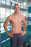 Fit swimmer by pool at leisure center Stock Photo