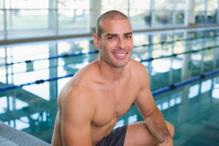 Fit swimmer by the pool at leisure center Royalty Free Stock Photography
