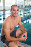 Fit swimmer by pool at leisure center Royalty Free Stock Photos