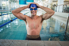 Fit swimmer in the pool at leisure center Royalty Free Stock Image