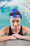 Fit swimmer in the pool smiling at camera Royalty Free Stock Images