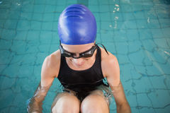 Fit swimmer in the pool smiling Stock Photo
