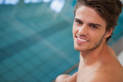 Fit swimmer smiling up at camera by the pool Royalty Free Stock Photos