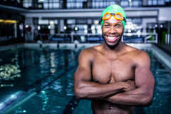 Fit swimmer standing with arms crossed Royalty Free Stock Photography