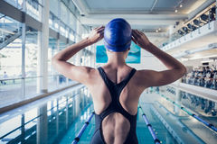 Fit swimmer standing by the pool Royalty Free Stock Photos