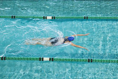 Fit swimmer training by herself. In swimming pool at the leisure centre stock images