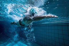 Fit swimmer training by himself Stock Images