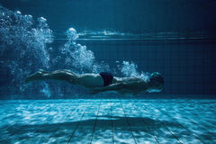 Fit swimmer training by himself Stock Image