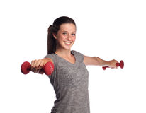 Fit teenager lifting weights Royalty Free Stock Photography