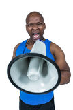 Fit trainer shouting through megaphone Royalty Free Stock Images