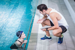 Fit trainer talking to swimmer Royalty Free Stock Image