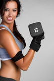 Fit Woman. Fit exercising woman lifting weights royalty free stock images