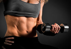 Fit woman abdomen. Muscle definition close up Royalty Free Stock Photos