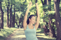 Fit woman arms raised up to sky celebrating freedom Stock Photos