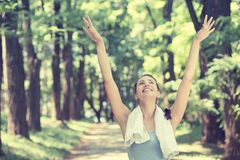 Fit woman arms raised up to sky celebrating freedom Stock Images