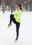 Fit woman athlete doing stretches female runner Stock Photography