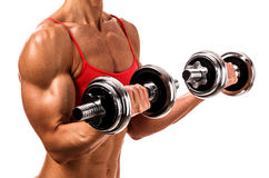 Fit woman with barbells Stock Images