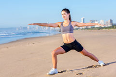Fit woman beach Stock Image