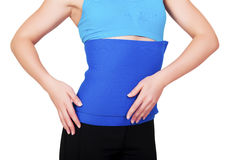 Fit woman with belt for weight loss isolated over white background Royalty Free Stock Photos