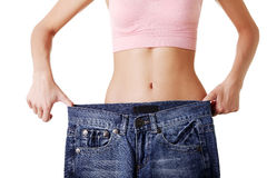 Fit woman with big pants Stock Photography