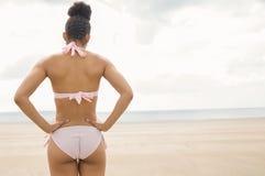Fit woman in bikini looking to sea Royalty Free Stock Photos
