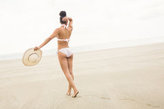 Fit woman in bikini walking to sea Royalty Free Stock Image