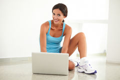 Fit woman browsing the web on laptop Stock Images