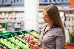 Fit Woman Buying Apples at Supermarket Stock Photos