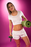 Fit woman carrying exercise equipment Stock Photos