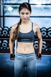 Fit woman with clenched fist. At gym Royalty Free Stock Photography