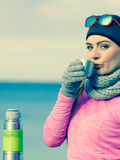Fit woman in cold day warming up drink tea Royalty Free Stock Photo