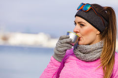 Fit woman in cold day warming up drink tea Stock Image