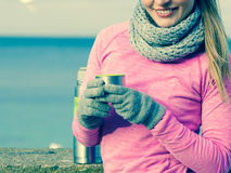 Fit woman in cold day warming up drink tea Stock Photo