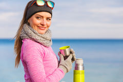 Fit woman in cold day warming up drink tea Royalty Free Stock Photos