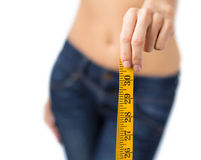 Fit woman confidently showing measurement tape Stock Images