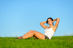 Fit woman on crunches workout outdoor Royalty Free Stock Image