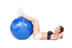Fit woman developing her abs using exercise ball Stock Photos