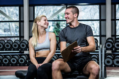 Fit woman discussing performance with trainer Royalty Free Stock Photography