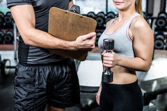 Fit woman discussing performance with trainer Royalty Free Stock Photo