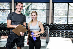 Fit woman discussing performance with trainer Stock Photography