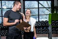 Fit woman discussing performance with trainer Stock Images
