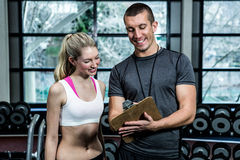 Fit woman discussing performance with trainer Royalty Free Stock Photos