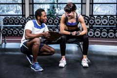 Fit woman discussing performance with trainer Royalty Free Stock Images