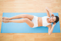 Fit woman doing abdominal crunches Royalty Free Stock Photos