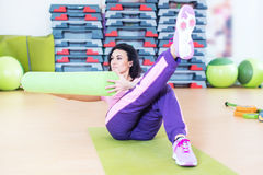 Fit woman doing abs workout exercise russian twists with raised leg.  stock images