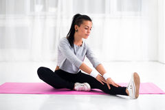 Fit woman doing aerobics gymnastics stretching Royalty Free Stock Photo