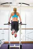 Fit woman doing crossfit fitness workout in gym Stock Image